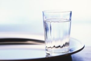 a-glass-of-water-on-a-tray