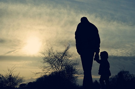 father-child-walking-silhouette